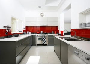 The red gives a degree of warmth to a slick fingergroove kitchen
